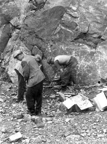 Men packing dynamite